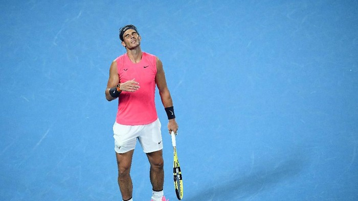 MELBOURNE, AUSTRALIA - JANUARY 29: Rafael Nadal of Spain reacts during his Men's Singles Quarterfinal match against Dominic Thiem of Austria on day ten of the 2020 Australian Open at Melbourne Park on January 29, 2020 in Melbourne, Australia. (Photo by Hannah Peters/Getty Images)