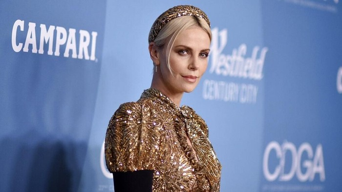 Actress Charlize Theron accepts the Spotlight Award during the 22nd Annual Costume Designers Guild Awards at the Beverly Hilton, Tuesday, Jan. 28, 2020, in Beverly Hills, Calif. (AP Photo/Chris Pizzello)