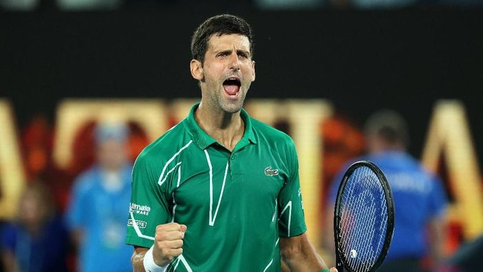 MELBOURNE, AUSTRALIA - JANUARY 30: Novak Djokovic of Serbia celebrates after winning his Mens Singles Semifinal match against Roger Federer of Switzerland on day eleven of the 2020 Australian Open at Melbourne Park on January 30, 2020 in Melbourne, Australia. (Photo by Clive Brunskill/Getty Images)