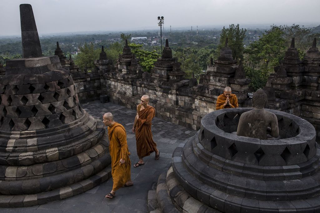 MAGELANG, CENTRAL JAVA, INDONESIA - MAY 10: Tourists at Borobudur temple during celebrations for Vesak Day on May 10, 2017 in Magelang, Central Java, Indonesia. Buddhists in Indonesia celebrate Vesak at the Borobudur temple annually, which makes it the most visited tourist attraction in Indonesia. It is observed during the full moon in May or June, with the ceremony centered at three Buddhist temples by walking from Mendut to Pawon and ending at Borobudur. The stages of life of Buddhism's founder, Gautama Buddha, which are celebrated at Vesak are his birth, enlightenment to Nirvana, and his passing (Parinirvana). (Photo by Ulet Ifansasti/Getty Images)