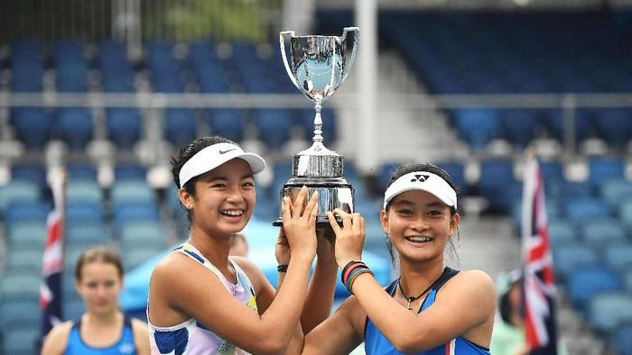 MELBOURNE, AUSTRALIA - JANUARY 31: Alexandra Eala of the Philippines and Priska Madelyn Nugroho of Indonesia pose with the championship trophy after winning their Junior Girls DoublesFinal against Ziva Falkner of Slovenia and Matilda Mutavdzic of Great Britain on day twelve of the 2020 Australian Open at Melbourne Park on January 31, 2020 in Melbourne, Australia. (Photo by Morgan Hancock/Getty Images)