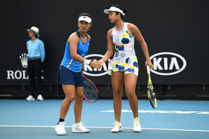 MELBOURNE, AUSTRALIA - JANUARY 31: Alexandra Eala of the Philippines and Priska Madelyn Nugroho of Indonesia play in their Junior Girls' DoublesFinal against Ziva Falkner of Slovenia and Matilda Mutavdzic of Great Britain on day twelve of the 2020 Australian Open at Melbourne Park on January 31, 2020 in Melbourne, Australia. (Photo by Morgan Hancock/Getty Images)