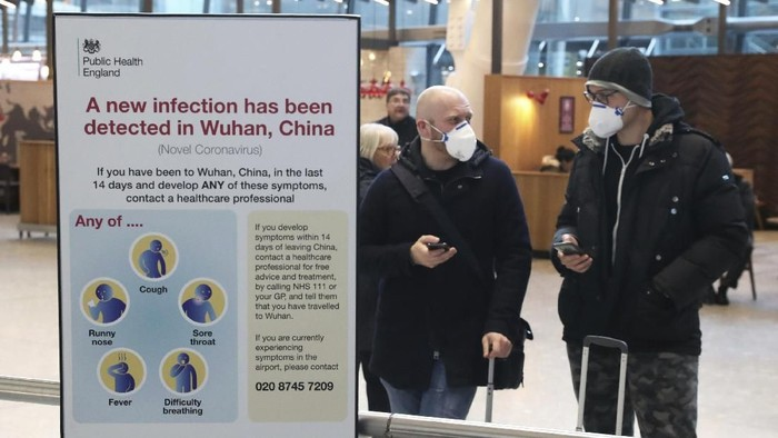 Passengers arrive at Heathrow Airport in London after the last British Airways flight from China touched down in the UK following an announcement that the airline was suspending all flights to and from mainland China with immediate effect amid the escalating coronavirus crisis, Wednesday Jan. 29, 2020. Many governments have warned against unnecessary travel to China, as efforts to contain a new and deadly coronavirus virus intensify. (Steve Parsons/PA via AP)