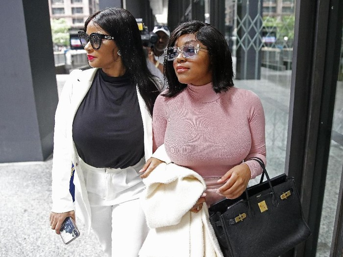CHICAGO, ILLINOIS - JULY 16: Supporters of singer R. Kelly, (R-L) Azriel Clary and Joycelyn Savage, leave after the singers arraignment at the Dirksen Federal Building on July 16, 2019 in Chicago, Illinois. (Photo by Nuccio DiNuzzo/Getty Images)