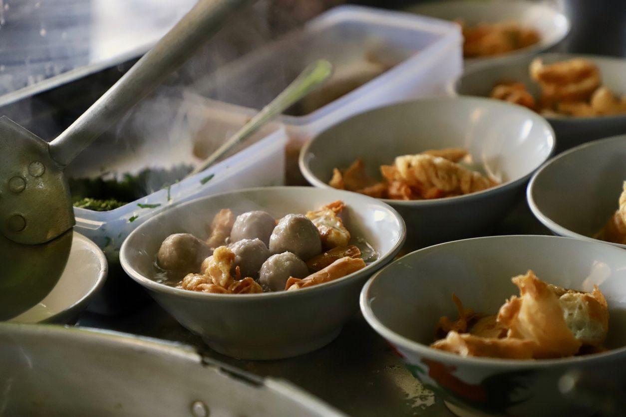 Bakso Cuanki, a Sundanese street food dish of fried wonton dumplings and meatballs in hot beef broth.
