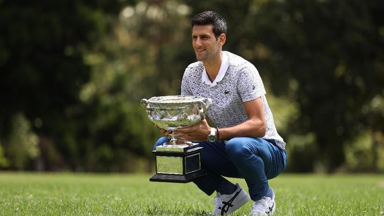 MELBOURNE, AUSTRALIA - FEBRUARY 03: Novak Djokovic of Serbia poses during the 2020 Australian Open Mens Trophy Media Opportunity at Royal Botanic Gardens Victoria on February 03, 2020 in Melbourne, Australia. (Photo by Clive Brunskill/Getty Images)