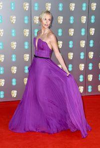 Gaun couture Dior menjadi andalan Charlize Theron di BAFTAs 2020.