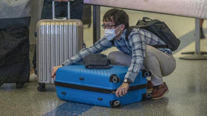 Lebih dari 20 ribu orang terinfeksi virus corona di berbagai negara dunia. Hal itu membuat AS larang penumpang masuk dari China untuk cegah penyebaran virus itu