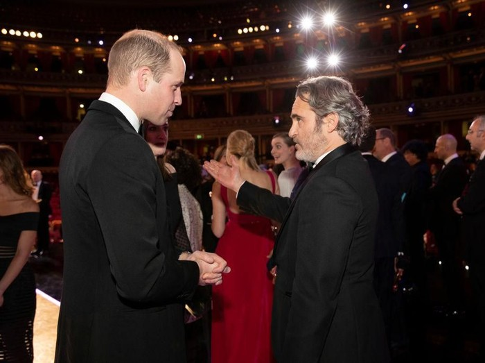 LONDON, ENGLAND - FEBRUARY 02: Prince William, Duke of Cambridge speaks with BAFTA winner Joaquin Phoenix at the EE British Academy Film Awards 2020 at Royal Albert Hall on February 2, 2020 in London, England. (Photo by Jeff Gilbert - WPA Pool / Getty Images)