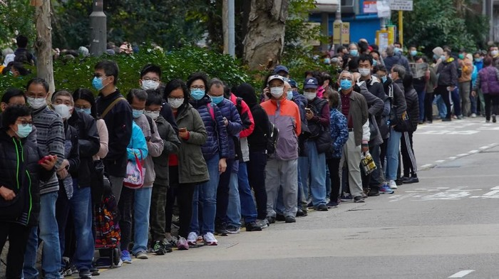 People queue up to buy face masks at a cosmetics shop in Hong Kong, Thursday, Jan. 30, 2020. The death toll rose to 170 in the new virus outbreak in China on Thursday as foreign evacuees from the worst-hit region begin returning home under close observation and world health officials expressed great concern that the disease is starting to spread between people outside of China. (AP Photo/Vincent Yu)