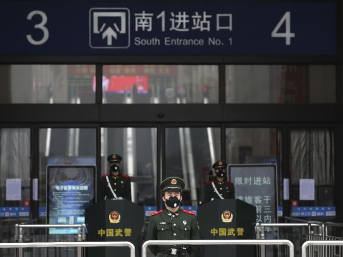 FILE - In this Jan. 23, 2020, file photo, Chinese paramilitary police stand guard outside the closed Hankou Railway Station in Wuhan in central Chinas Hubei Province. Cutting off access to entire cities with millions of residents to stop a new virus outbreak is a step few countries other than China would consider, but it is made possible by the ruling Communist Partys extensive social controls and experience fighting the 2002-03 outbreak of SARS. (Chinatopix via AP, File)