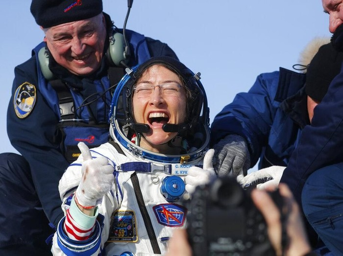 U.S. astronaut Christina Koch reacts shortly after the landing of the Russian Soyuz MS-13 space capsule about 150 km ( 80 miles) south-east of the Kazakh town of Zhezkazgan, Kazakhstan, Thursday, Feb. 6, 2020. A Soyuz space capsule with U.S. astronaut Christina Koch, Italian astronaut Luca Parmitano and Russian cosmonaut Alexander Skvortsov, returning from a mission to the International Space Station landed safely on Thursday on the steppes of Kazakhstan. Koch wrapped up a 328-day mission on her first flight into space, providing researchers the opportunity to observe effects of long-duration spaceflight on a woman as the agency plans to return to the Moon under the Artemis program. (Sergei Ilnitsky/Pool Photo via AP)