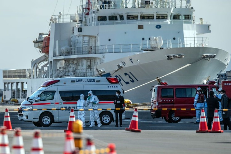 YOKOHAMA, JAPAN - FEBRUARY 06: An ambulance carries a coronavirus victim from the Diamond Princess cruise ship while it is docked at Daikoku Pier where it will be resupplied and newly diagnosed coronavirus cases taken to hospital as it remains in quarantine off the port of Yokohama after a number of the 3,700 people on board were confirmed to have coronavirus, on February 6, 2020 in Yokohama, Japan. 20 passengers are confirmed to be infected with coronavirus as Japanese authorities continue screening people on board. The new cases bring the total number of confirmed infections to 45 in Japan, the largest number outside of China. (Photo by Carl Court/Getty Images)