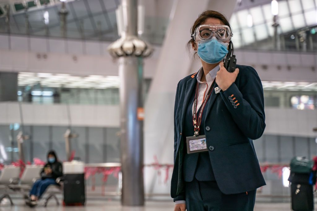 BEIJING, CHINA - JANUARY 30: A sign instructs shoppers to wear protective masks at a mall on January 30, 2020 in Beijing, China. The number of cases of a deadly new coronavirus rose to over 7000 in mainland China Thursday as the country continued to lock down the city of Wuhan in an effort to contain the spread of the pneumonia-like disease which medicals experts have confirmed can be passed from human to human. In an unprecedented move, Chinese authorities put travel restrictions on the city which is the epicentre of the virus and neighbouring municipalities affecting tens of millions of people. The number of those who have died from the virus in China climbed to over 170 on Thursday, mostly in Hubei province, and cases have been reported in other countries including the United States, Canada, Australia, Japan, South Korea, and France. The World Health Organization has warned all governments to be on alert, and its emergency committee is to meet later on Thursday to decide whether to declare a global health emergency. (Photo by Kevin Frayer/Getty Images)