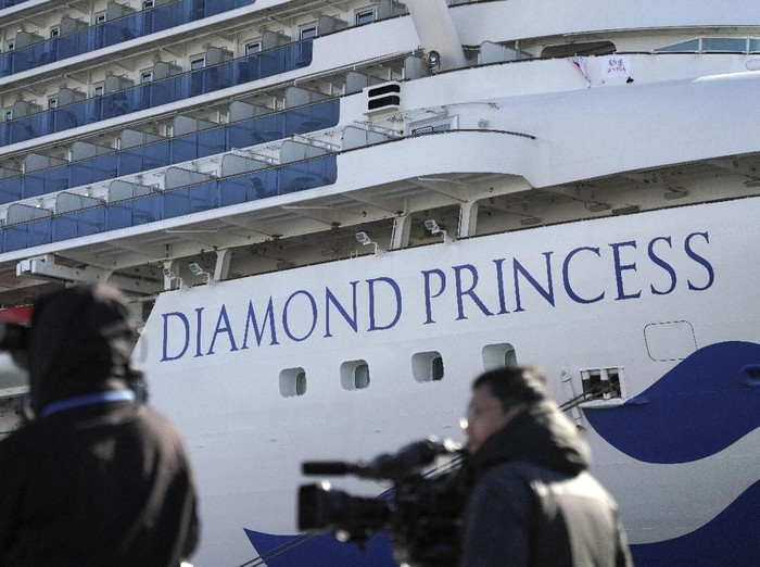 The quarantined cruise ship Diamond Princess is anchored in the Yokohama Port Sunday, Feb. 9, 2020. Japan on Saturday reported three more cases of the coronavirus aboard the Diamond Princess for a total of 64 . There are 3,700 passengers and crew on the Diamond Princess who must remain on board for 14 days. (AP Photo/Eugene Hoshiko)