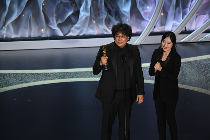 HOLLYWOOD, CALIFORNIA - FEBRUARY 09: (L-R) Bong Joon-ho accepts the International Feature Film award for Parasite with interpreter Sharon Choi onstage during the 92nd Annual Academy Awards at Dolby Theatre on February 09, 2020 in Hollywood, California. (Photo by Kevin Winter/Getty Images)