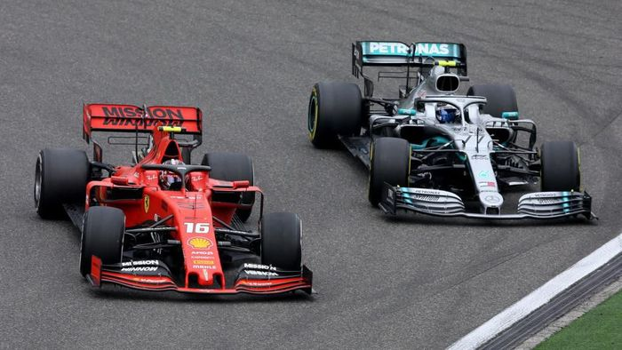 SHANGHAI, CHINA - APRIL 14: Charles Leclerc of Monaco driving the (16) Scuderia Ferrari SF90 leads Valtteri Bottas driving the (77) Mercedes AMG Petronas F1 Team Mercedes W10 on track during the F1 Grand Prix of China at Shanghai International Circuit on April 14, 2019 in Shanghai, China. (Photo by Charles Coates/Getty Images)