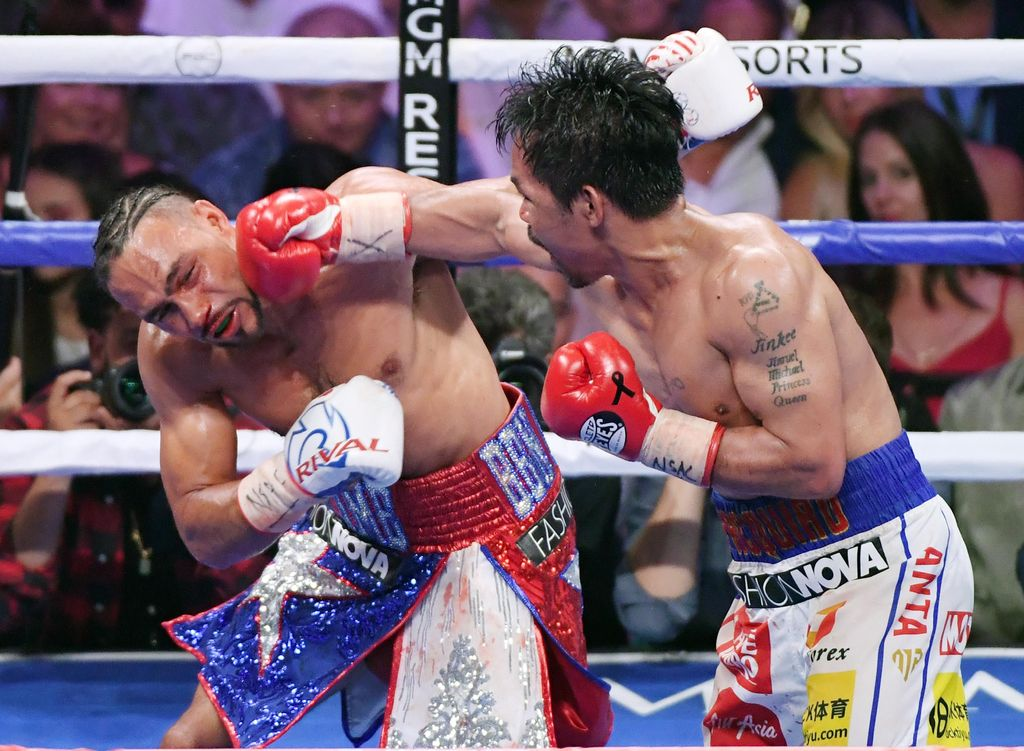 LAS VEGAS, NEVADA - JULY 20:  Manny Pacquiao (R) throws a right at Keith Thurman in the eighth round of their WBA welterweight title fight at MGM Grand Garden Arena on July 20, 2019 in Las Vegas, Nevada. Pacquiao won in a split decision.  (Photo by Ethan Miller/Getty Images)