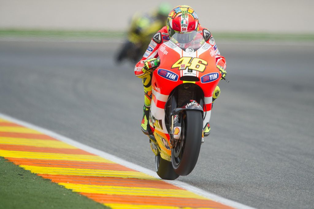 VALENCIA, SPAIN - NOVEMBER 05:  Valentino Rossi of Italy and Ducati Marlboro Team lifts the front wheel during the qualifying practice of the MotoGP of Valencia at Ricardo Tormo Circuit on November 5, 2011 in Valencia, Spain.  (Photo by Mirco Lazzari gp/Getty Images)