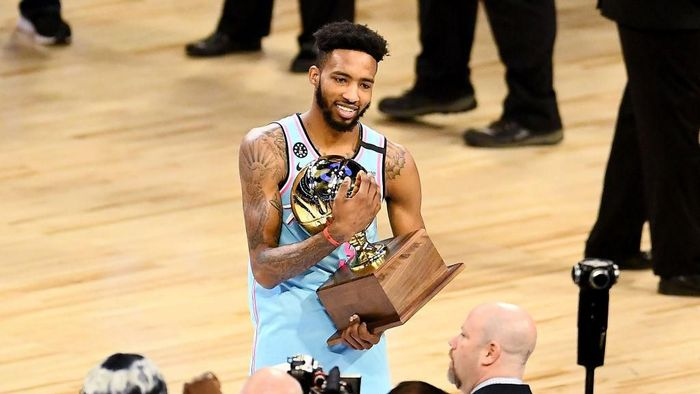 CHICAGO, ILLINOIS - FEBRUARY 15: Derrick Jones Jr. #5 of the Miami Heat celebrates with the trophy after winning the 2020 NBA All-Star - AT&T Slam Dunk Contest during State Farm All-Star Saturday Night at the United Center on February 15, 2020 in Chicago, Illinois. NOTE TO USER: User expressly acknowledges and agrees that, by downloading and or using this photograph, User is consenting to the terms and conditions of the Getty Images License Agreement. (Photo by Stacy Revere/Getty Images)