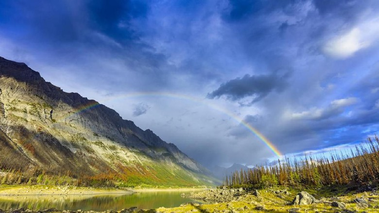 Rainbow in Medicine Lake area in Jasper National Park