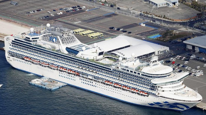 The quarantined Diamond Princess cruise ship is anchored at a port in Yokohama, near Tokyo Wednesday, Feb. 19, 2020. The passengers tested negative for COVID-19 will start disembarking Wednesday. (Yuta Omori/Kyodo News via AP)