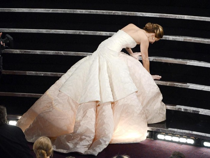HOLLYWOOD, CA - FEBRUARY 24:  Actress Jennifer Lawrence reacts after winning the Best Actress award for Silver Linings Playbook during the Oscars held at the Dolby Theatre on February 24, 2013 in Hollywood, California.  (Photo by Kevin Winter/Getty Images)