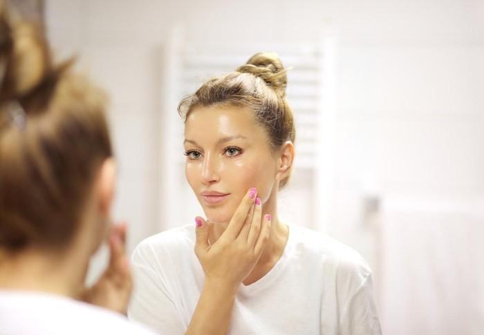 Magic anti-aging cream.Applying the cream