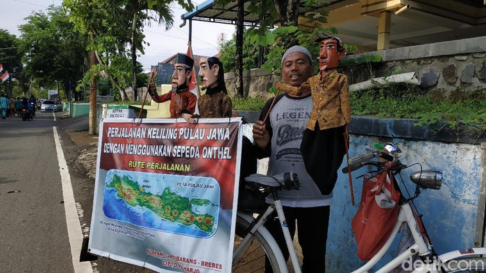 Aksi Cipto Raharjo (53) tergolong nekat. Terdorong keinginan bertemu Presiden Jokowi, pria asli Brebes, Jateng ini nekat bersepeda keliling Pulau Jawa.