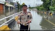 Cerita AKBP Dermawan yang Laporkan Banjir Jakarta Sambil Pegang Ular