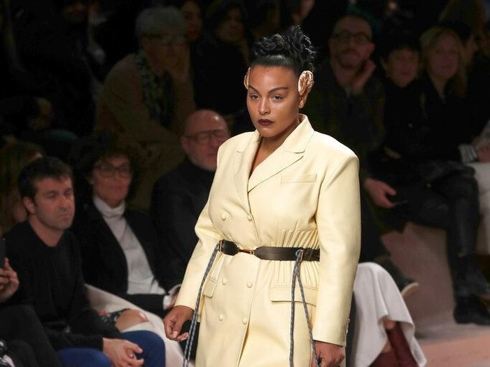 Paloma Elsesser wears a creation as part of Fendis Fall/Winter 2020/2021 collection, presented in Milan, Italy, Thursday, Feb. 20, 2020. (AP Photo/Antonio Calanni)