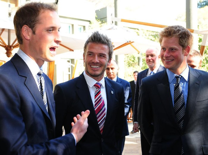 JOHANNESBERG, SOUTH AFRICA - JUNE 19:  Prince William and Prince Harry (R) smile with David Beckham (C) at an FA reception at the Saxon Hotel on June 19, 2010 in Johannesberg, South Africa. (Photo by Owen Humphreys - WPA Pool/Getty Images)