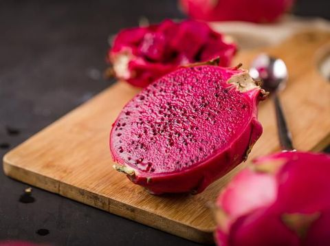 Pitaya cut in half on black background