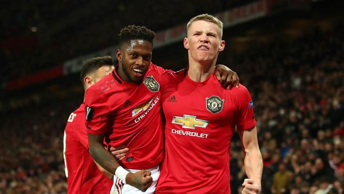 MANCHESTER, ENGLAND - FEBRUARY 27: Scott McTominay of Manchester United celebrates with teammate Fred of Manchester United after scoring his teams third goal during the UEFA Europa League round of 32 second leg match between Manchester United and Club Brugge at Old Trafford on February 27, 2020 in Manchester, United Kingdom. (Photo by Clive Brunskill/Getty Images)