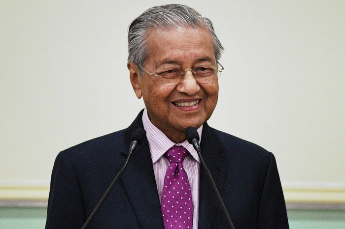 Malaysias interim Prime Minister Mahathir Mohamad smiles during a press conference after unveiling an economic stimulus plan aimed at combating the impact of the COVID-19 novel coronavirus at the Prime Ministers Office in Putrajaya on February 27, 2020. (Photo by Mohd RASFAN / AFP)