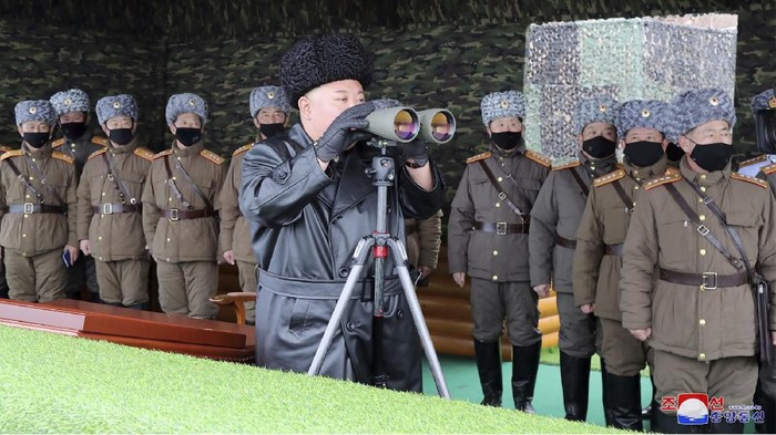 FILE - In this Friday, Feb. 28, 2020, file photo provided on Feb. 29, 2020 by the North Korean government, North Korean leader Kim Jong Un, center, inspects the military drill of units of the Korean Peoples Army, with soldiers shown wearing face masks. South Korea's military says North Korea has fired at least one unidentified projectile. The launch on Monday, March 2, 2020 came two days North Korea's state media said leader Kim supervised an artillery drill aimed at testing the combat readiness of units in front-line and eastern areas. Independent journalists were not given access to cover the event depicted in this image distributed by the North Korean government. The content of this image is as provided and cannot be independently verified. Korean language watermark on image as provided by source reads: KCNA which is the abbreviation for Korean Central News Agency. (Korean Central News Agency/Korea News Service via AP, File)
