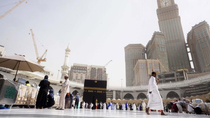 A small number of pilgrims circumambulate around the Kaaba, the cubic building at the Grand Mosque, during the minor pilgrimage, known as Umrah, in the Muslim holy city of Mecca, Saudi Arabia, Monday, March 2, 2020. At Islam's holiest site in Mecca, restrictions put in place by Saudi Arabia to halt the spread of the new coronavirus saw far smaller crowds than usual on Monday. (AP Photo/Amr Nabil)