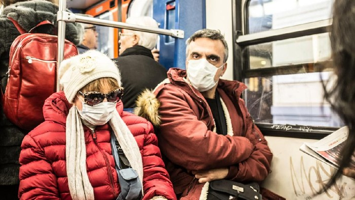 Athens, Greece - February 18, 2019: The H1N1 virus, known as swine flu, has killed 56 people in Greece. In February of  2019, 18 people in intensive care units died due to H1N1 virus. People protect their self with the mask.