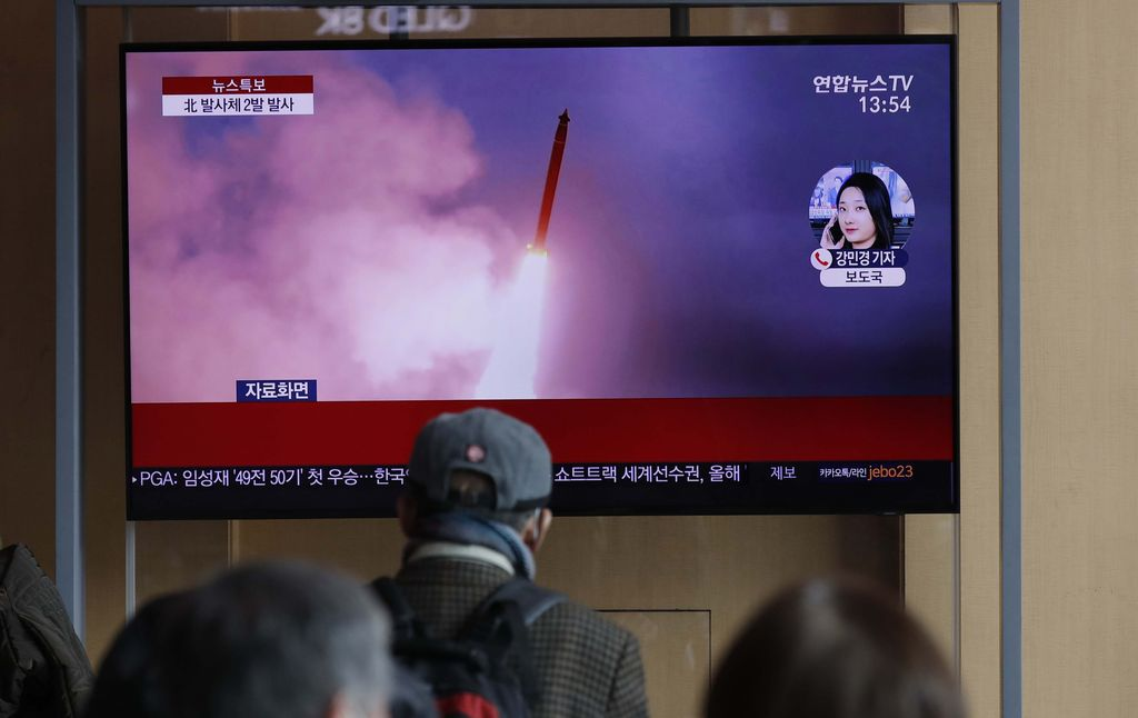 People watch a TV screen showing a news program reporting about North Korea's firing of projectiles with a file image at the Seoul Railway Station in Seoul, South Korea, Monday, March 2, 2020. North Korea fired two unidentified projectiles into its eastern sea on Monday as it begins to resume weapons demonstrations after a months-long hiatus that could have been forced by the coronavirus crisis in Asia. The Korean letters read: