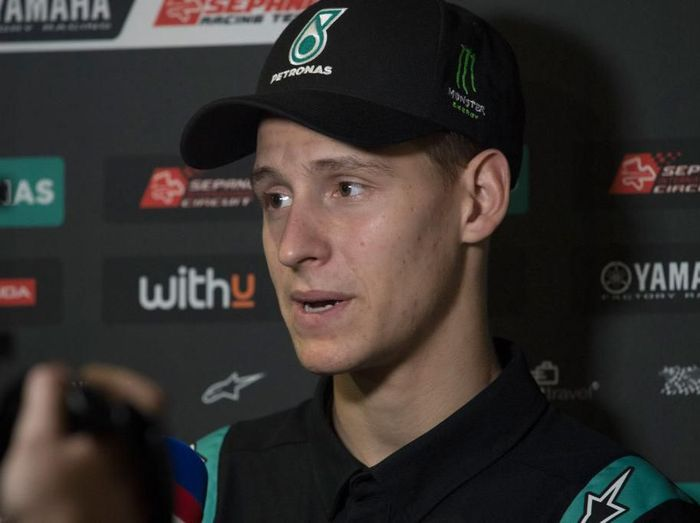 DOHA, QATAR - FEBRUARY 23:  Fabio Quartararo of France and Petronas Yamaha SRT    speaks with journalists during the MotoGP Tests at Losail Circuit on February 23, 2020 in Doha, Qatar. (Photo by Mirco Lazzari gp/Getty Images)