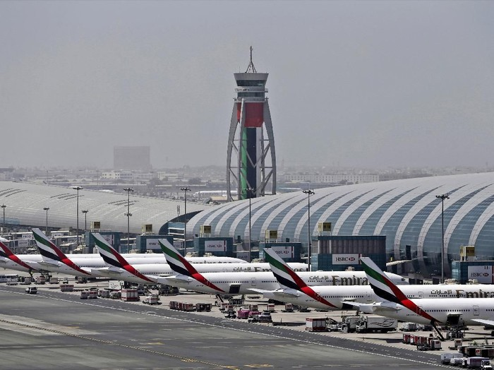 FILE - In this April 20, 2017 file photo, Emirates planes are parked at the Dubai International Airport in Dubai, United Arab Emirates. Major disruptions due to the new coronavirus have already caused the equivalent of a roughly $100 million loss to airline carriers in the Middle East region, which serves as a connection hub for east-west travel, the industrys main trade association said on Monday, March 2, 2020. (AP Photo/Kamran Jebreili, File)