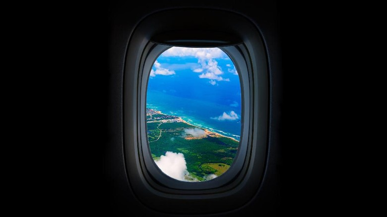 Costline, sea and sky from the airplanes Porthole. Dominican Republic