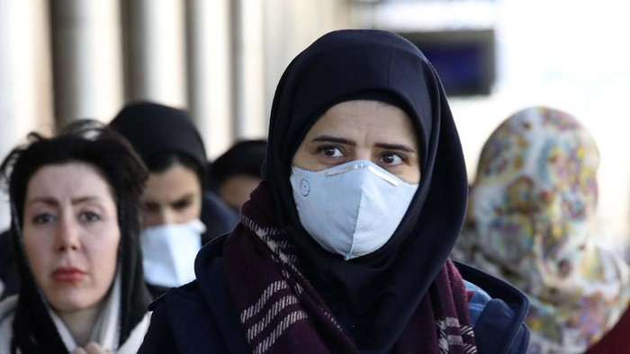 Some women wear face masks as they walk in downtown Tehran, Iran, Monday, March 2, 2020. A member of a council that advises Irans supreme leader died Monday after falling sick from the new coronavirus, becoming the first top official to succumb to the illness striking both citizens and leaders of the Islamic Republic. (AP Photo Vahid Salemi)