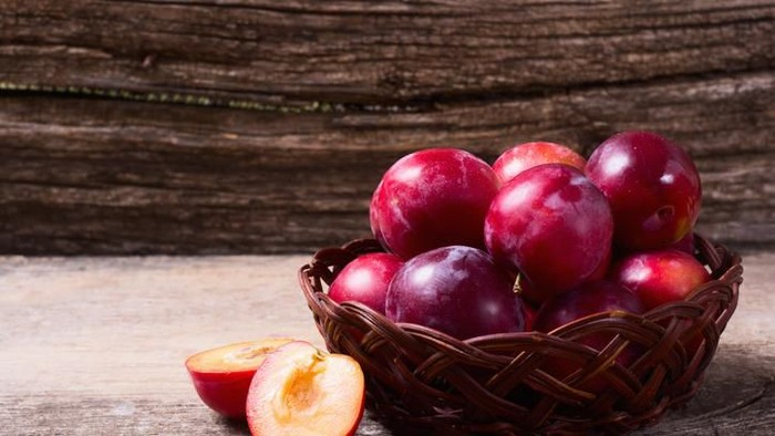 red plums isolated