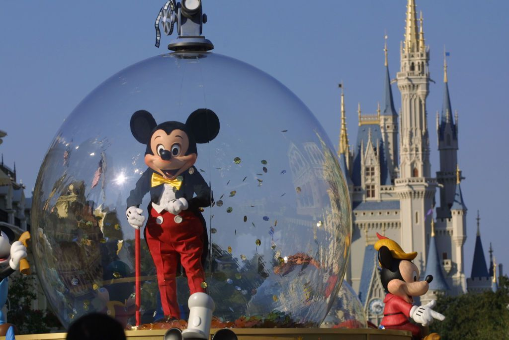 397155 06: Mickey Mouse rides in a parade through Main Street, USA with Cinderella's castle in the background at Disney World's Magic Kingdom November 11, 2001 in Orlando, Florida. (Photo by Joe Raedle/Getty Images)