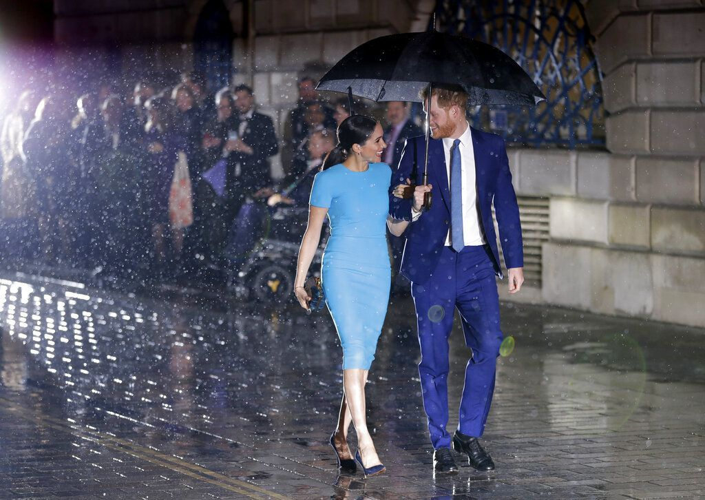 Britain's Prince Harry and Meghan, the Duchess of Sussex, leave after attending the annual Endeavour Fund Awards in London, Thursday, March 5, 2020. The awards celebrate the achievements of service personnel who were injured in service and have gone on to use sport as part of their recovery and rehabilitation. (AP Photo/Kirsty Wigglesworth)