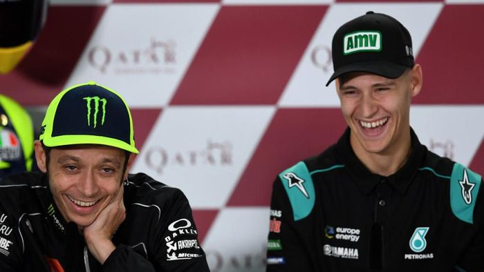 Yamaha MotoGPs Valentino Rossi of Italy (L) and Petronas Yamaha SRTs Fabio Quartararo attend a press conference at Losail Circuit in Doha on March 7, 2019, ahead of the seasons start at Qatar MotoGP grand prix on March 10. (Photo by GIUSEPPE CACACE / AFP)