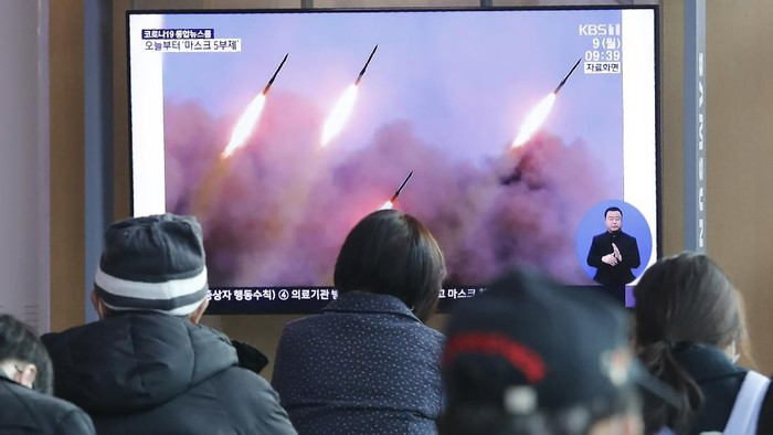 People watch a TV showing file images of North Koreas missile launch during a news program at the Seoul Railway Station in Seoul, South Korea, Monday, March 9, 2020. North Korea fired three unidentified projectiles off its east coast on Monday, South Koreas military said, two days after the North threatened to take momentous action to protest outside condemnation over its earlier live-fire exercises. (AP Photo/Ahn Young-joon)