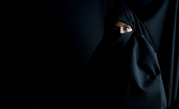 Fashion portrait of a Muslim woman wearing the hijab and looking at the camera