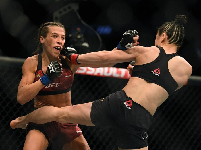 LAS VEGAS, NEVADA - MARCH 07:  Joanna Jedrzejczyk punches Weili Zhang in a split decision loss during a strawweight title bout at T-Mobile Arena on March 07, 2020 in Las Vegas, Nevada. (Photo by Harry How/Getty Images)